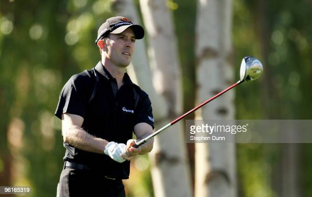 Mike Weir of Canada watches his tee shot on the second hole at the Palmer Private course at PGA West during the final round of the Bob Hope Classic...