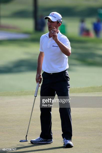 Mike Weir of Canada waves to the gallery on the 18th green during the second round of the 2014 Masters Tournament at Augusta National Golf Club on...