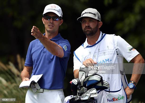 Mike Weir prepares to play his tee shot on the second hole during the first round of the Wyndham Championship at Sedgefield Country Club on August 14...