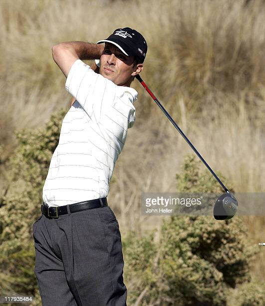 Mike Weir watches as his ball travels down the fourteenth fairway during the third round of play at the Target World Challenge