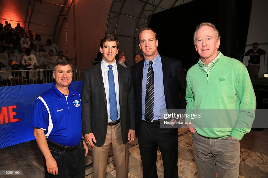 Mike White, Eli Manning, Peyton Manning and Archie Manning attend DIRECTV'S Seventh Annual Celebrity Beach Bowl at DTV SuperFan Stadium at Mardi Gras World on February 2, 2013 in New Orleans, Louisiana.