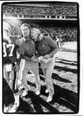 Mike White Offensive Line coach of the San Francisco 49ers congratulates head coach Bill Walsh after winning his first progame as a coach against the...
