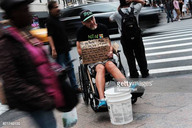 Mike who is homeless panhandles for money in Manhattan on July 24 2017 in New York City In its annual homeless count New York City recorded 3892...