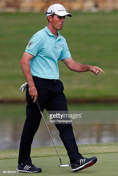 Mike Wier of Canada reacts after putting on the 18th green during Round Three of the HP Byron Nelson Championship at the TPC Four Seasons Resort on...