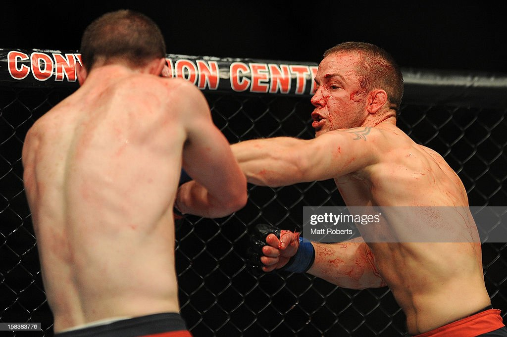 <a gi-track='captionPersonalityLinkClicked' href=/galleries/search?phrase=Mike+Wilkinson&family=editorial&specificpeople=206653 ng-click='$event.stopPropagation()'>Mike Wilkinson</a> (R) punches Brendan Loughnane during the Lightweight bout between <a gi-track='captionPersonalityLinkClicked' href=/galleries/search?phrase=Mike+Wilkinson&family=editorial&specificpeople=206653 ng-click='$event.stopPropagation()'>Mike Wilkinson</a> and Brendan Loughnane at Gold Coast Convention and Exhibition Centre on December 15, 2012 on the Gold Coast, Australia.