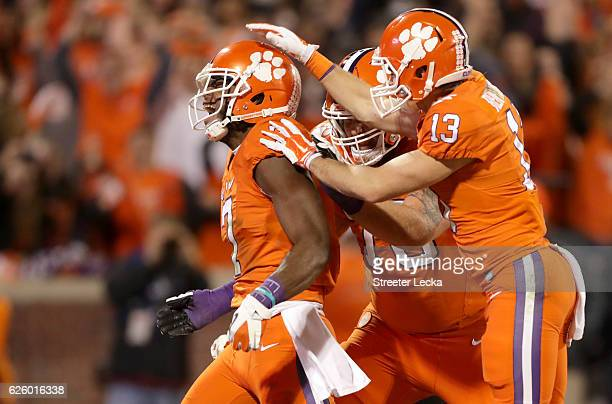 Mike Williams celebrates with teammates Hunter Renfrow and Sean Pollard of the Clemson Tigers after a touchdown against the South Carolina Gamecocks...