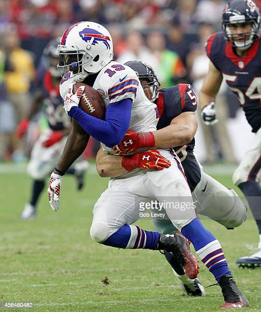 Mike Williams of the Buffalo Bills is tackled by Brian Cushing of the Houston Texans at NRG Stadium on September 28 2014 in Houston Texas