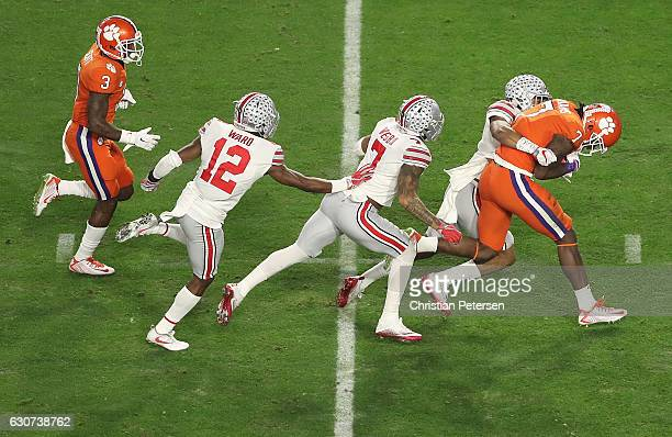 Mike Williams of the Clemson Tigers is chased down by Marshon Lattimore of the Ohio State Buckeyes Damon Webb and Denzel Ward during the first half...