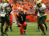 Mike Williams of the Syracuse Orange celebrates a first down during the game against the South Florida Bulls at the Carrier Dome on October 3 2009 in...
