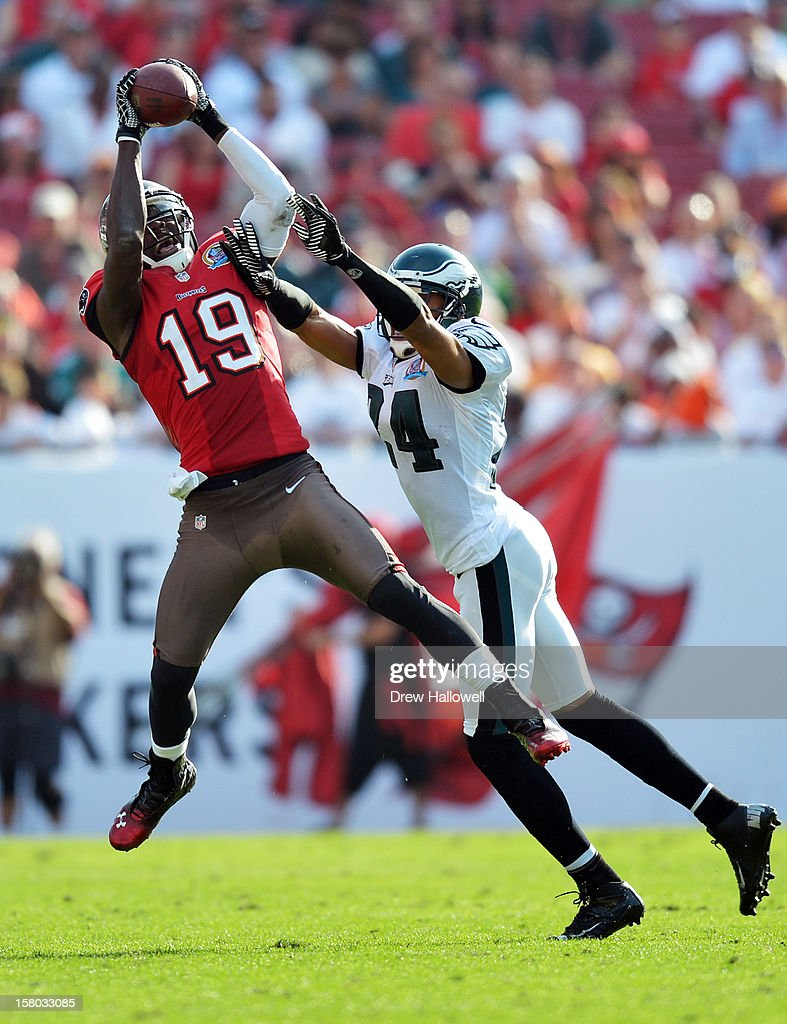Mike Williams #19 of the Tampa Bay Buccaneers catches a pass over <a gi-track='captionPersonalityLinkClicked' href=/galleries/search?phrase=Nnamdi+Asomugha&family=editorial&specificpeople=268240 ng-click='$event.stopPropagation()'>Nnamdi Asomugha</a> #24 of the Philadelphia Eagles at Raymond James Stadium on December 9, 2012 in Tampa, Florida. The Eagles won 23-21.
