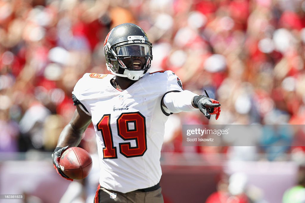 Mike Williams #19 of the Tampa Bay Buccaneers celebrates in the end zone in the first quarter after scoring a touchdown against the Arizona Cardinals at Raymond James Stadium on September 29, 2013 in Tampa, Florida.