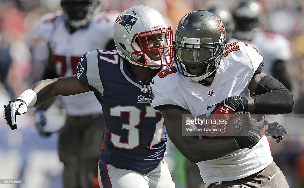 Mike Williams #19 of the Tampa Bay Buccaneers runs past <a gi-track='captionPersonalityLinkClicked' href=/galleries/search?phrase=Alfonzo+Dennard&family=editorial&specificpeople=5651216 ng-click='$event.stopPropagation()'>Alfonzo Dennard</a> #37 of the New England Patriots during the second half at Gillette Stadium on September 22, 2013 in Foxboro, Massachusetts.