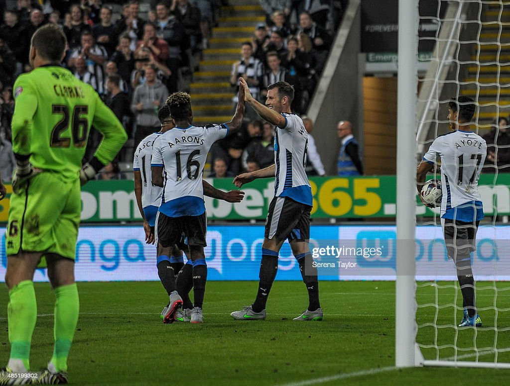 Mike Williamson (C) of Newcastle celebrates with team-mates after scoring the fourth goal for Newcastle during The Capital One Cup second round match between Newcastle United and Northampton Town at St.James Park on August 25, 2015, in Newcastle upon Tyne, England.