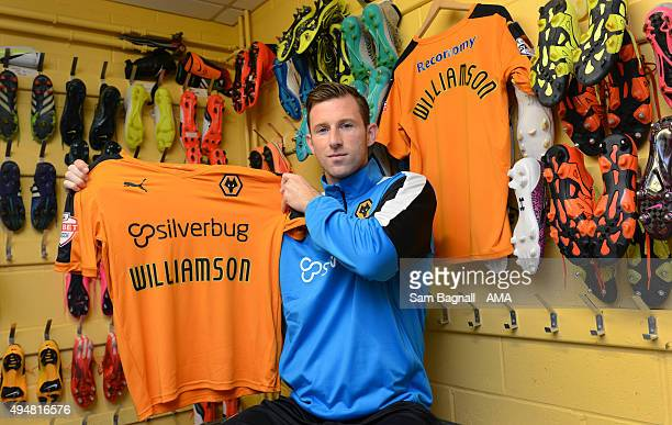 Mike Williamson signs on loan for Wolverhampton Wanderers at Molineux on October 29 2015 in Wolverhampton England