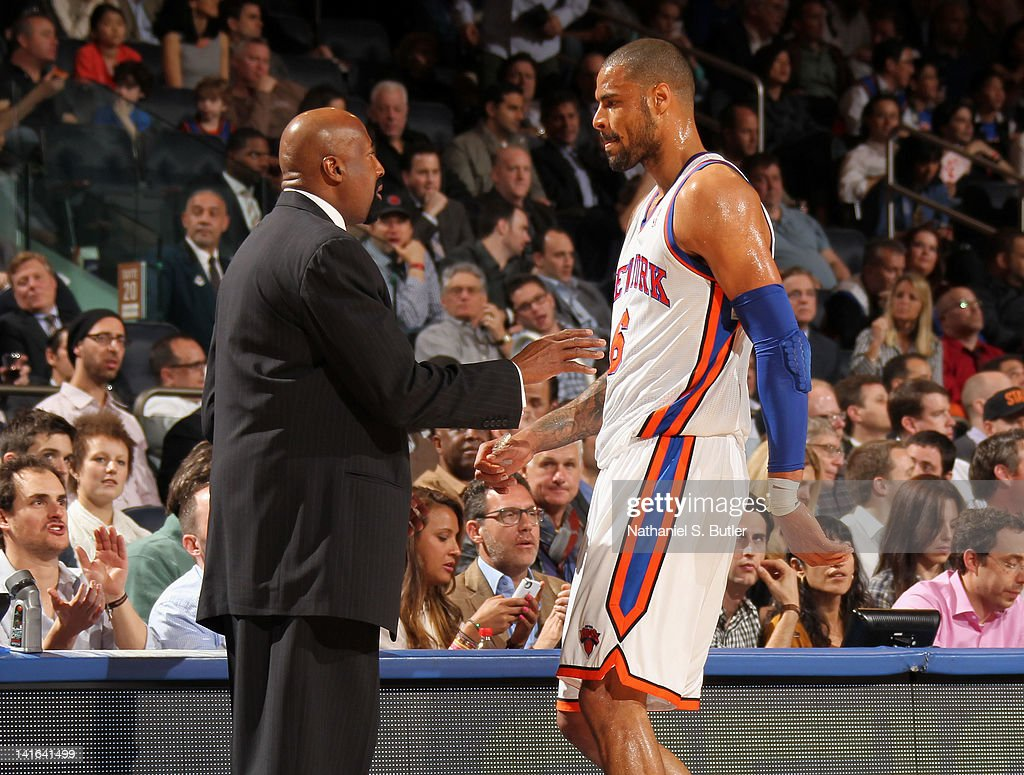 Mike Woodson and Tyson Chandler of the New York Knicks talk during the game against the Toronto Raptors on March 20 2012 at Madison Square Garden in...