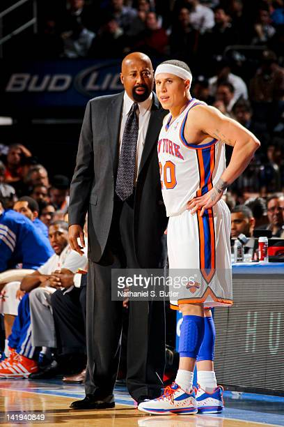 Mike Woodson interim head coach of the New York Knicks speaks to Mike Bibby during a game against the Milwaukee Bucks on March 26 2012 at Madison...