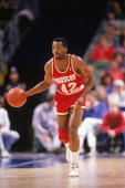 Mike Woodson of the Houston Rockets advances the ball during a game in the198889 season NOTE TO USER User expressly acknowledges and agrees that by...