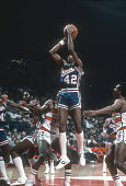 Mike Woodson of the Kansas City Kings shoots against the Washington Bullets during an NBA basketball game circa 1983 at the Capital Centre in...