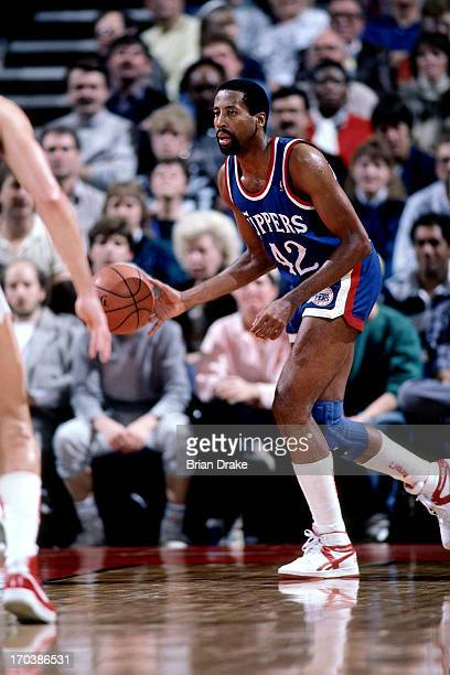 MIke Woodson of the Los Angeles Clippers dribbles the ball up court during a game played in 1986 at the Veterans Memorial Coliseum in Portland Oregon...
