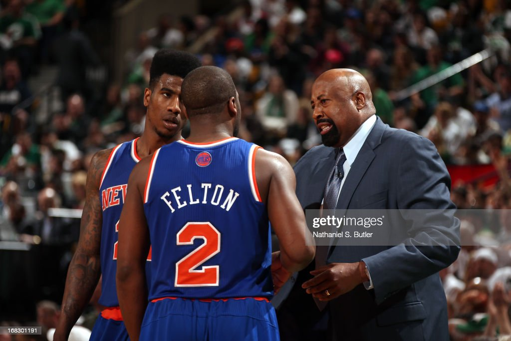 <a gi-track='captionPersonalityLinkClicked' href=/galleries/search?phrase=Mike+Woodson&family=editorial&specificpeople=213194 ng-click='$event.stopPropagation()'>Mike Woodson</a> of the New York Knicks talks with <a gi-track='captionPersonalityLinkClicked' href=/galleries/search?phrase=Iman+Shumpert&family=editorial&specificpeople=5042486 ng-click='$event.stopPropagation()'>Iman Shumpert</a> #21 and <a gi-track='captionPersonalityLinkClicked' href=/galleries/search?phrase=Raymond+Felton&family=editorial&specificpeople=209141 ng-click='$event.stopPropagation()'>Raymond Felton</a> #2 during the game against the Boston Celtics in Game Four of the Eastern Conference Quarterfinals during the 2013 NBA Playoffs on April 28, 2013 at the TD Garden in Boston.
