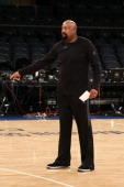 Mike Woodson of the New York Knicks warms up and coaches before the game against the Oklahoma City Thunder during a game at Madison Square Garden in...