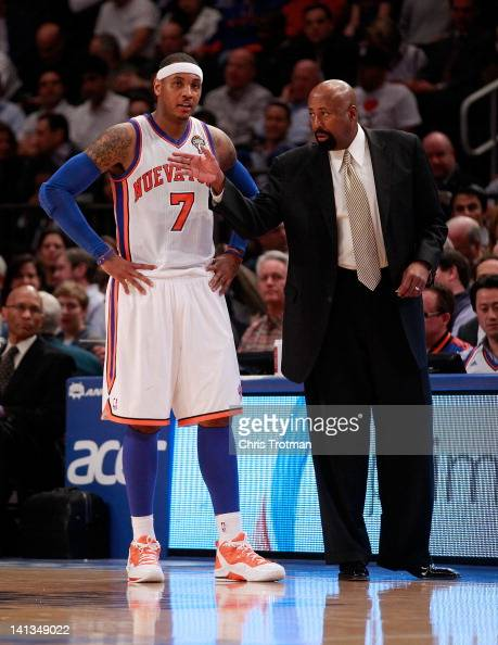 Mike Woodson the interim head coach of the New York Knicks talks with Carmelo Anthony of the New York Knicks during the game against the Portland...
