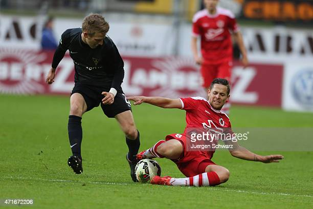 Mike Wunderlich of Cologne tackles Dominik Ernst of aachen during the Regionalliga West match between Alemannia Aachen and Viktoria Koeln at Tivoli...