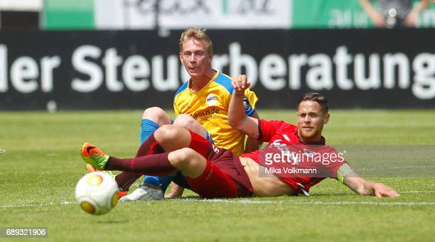 Mike Wunderlich of Viktoria Koeln challenges Sören Eismann of Jena during the Third League Plaffoff match between Viktoria Koeln and FC CZ Jena at...