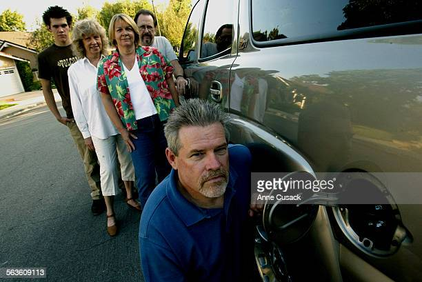 Mike Yancey in foreground with SUV his family will take on vacation Behind him L to R Joe Yancey age 17 Donna Kreutz Mary Lou Yancey and Bill Kreutz...