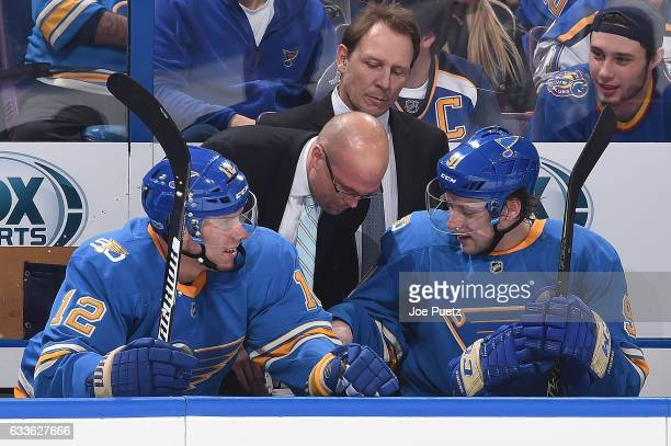 Mike Yeo head coach of the St Louis Blues talks with Jori Lehtera and Vladimir Tarasenko during a game against the Toronto Maple Leafs on February 2...
