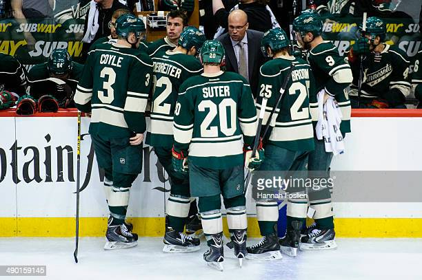 Mike Yeo of the Minnesota Wild speaks to his players in Game Three of the Second Round of the 2014 NHL Stanley Cup Playoffs against the Chicago...