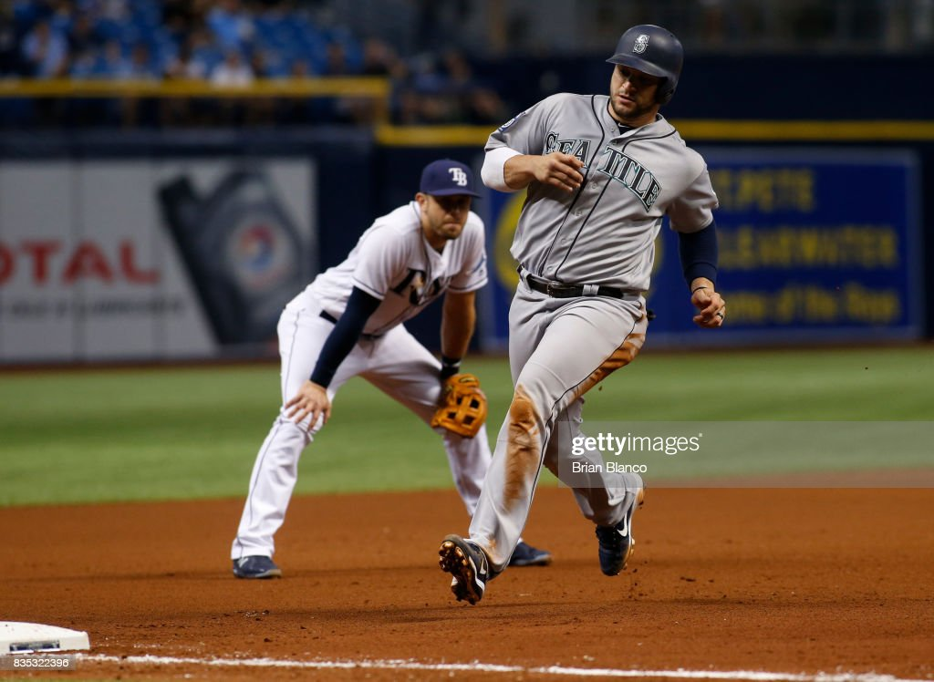 Mike Zunino #3 of the Seattle Mariners advances to third base in front of third baseman Evan Longoria #3 of the Tampa Bay Rays off of the single by Jean Segura during the fourth inning of a game on August 18, 2017 at Tropicana Field in St. Petersburg, Florida.