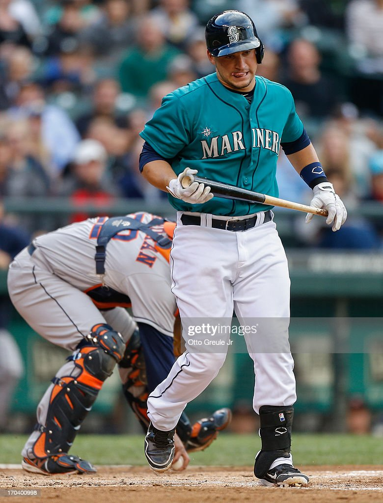 <a gi-track='captionPersonalityLinkClicked' href=/galleries/search?phrase=Mike+Zunino&family=editorial&specificpeople=6803368 ng-click='$event.stopPropagation()'>Mike Zunino</a> #3 of the Seattle Mariners heads back to the dugout after striking out in his first Major League at-bat in the second inning against the Houston Astros at Safeco Field on June 12, 2013 in Seattle, Washington.