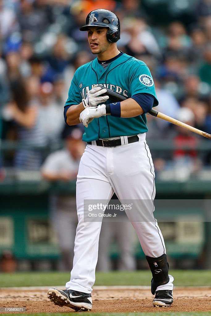 Mike Zunino #3 of the Seattle Mariners heads back to the dugout after striking out in his first Major League at-bat in the second inning against the Houston Astros at Safeco Field on June 12, 2013 in Seattle, Washington.