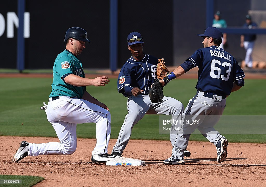 Mike Zunino #3 of the Seattle Mariners hustles back to second base avoiding the double play by Carlos Asuaje #63 of the San Diego Padres as teammate Jemile Weeks #8 looks on during the sixth inning at Peoria Stadium on March 2, 2016 in Peoria, Arizona. Mariners won 7-0.