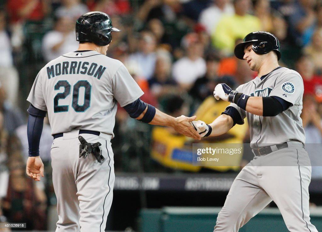 <a gi-track='captionPersonalityLinkClicked' href=/galleries/search?phrase=Mike+Zunino&family=editorial&specificpeople=6803368 ng-click='$event.stopPropagation()'>Mike Zunino</a> #3 of the Seattle Mariners receives congratulations from Logan Morrison #20 after hitting a home run against the Houston Astros at Minute Maid Park on June 30, 2014 in Houston, Texas.