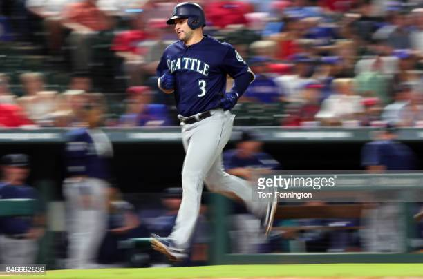 Mike Zunino of the Seattle Mariners rounds the bases after hitting a solo home run in the top of the fifth inning at Globe Life Park in Arlington on...