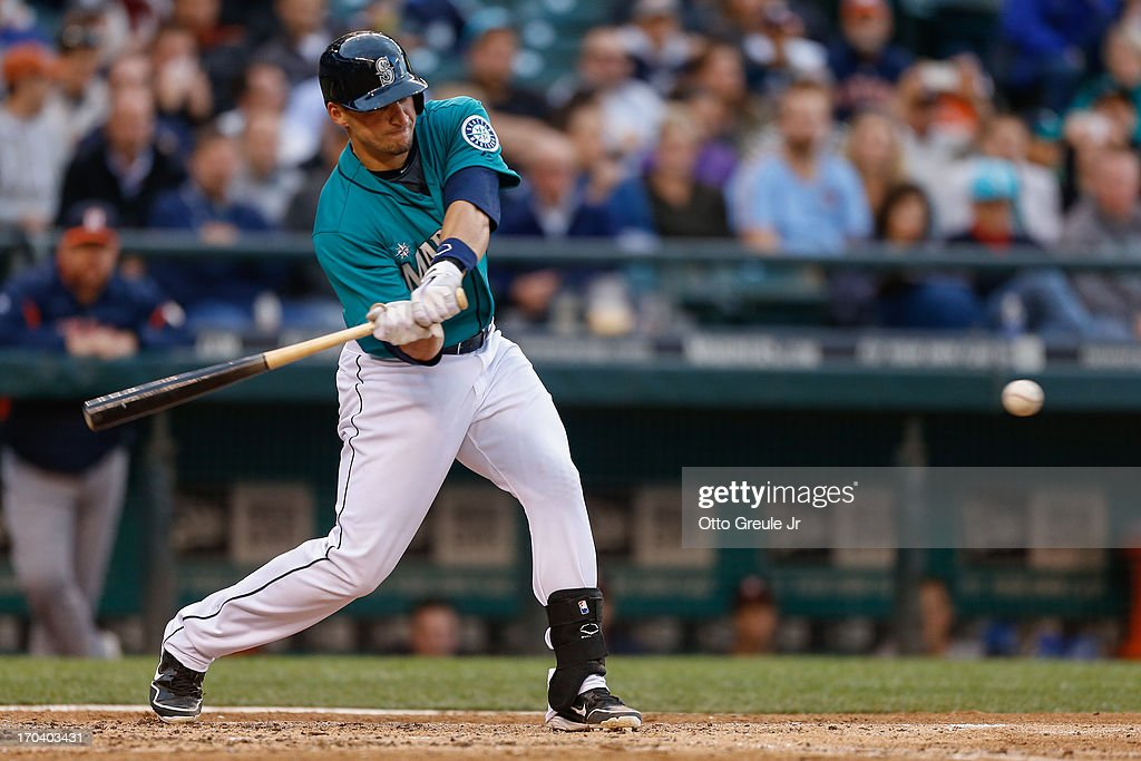 Mike Zunino #3 of the Seattle Mariners singles against the Houston Astros in the fourth inning at Safeco Field on June 12, 2013 in Seattle, Washington. The hit was the first of his Major League career.