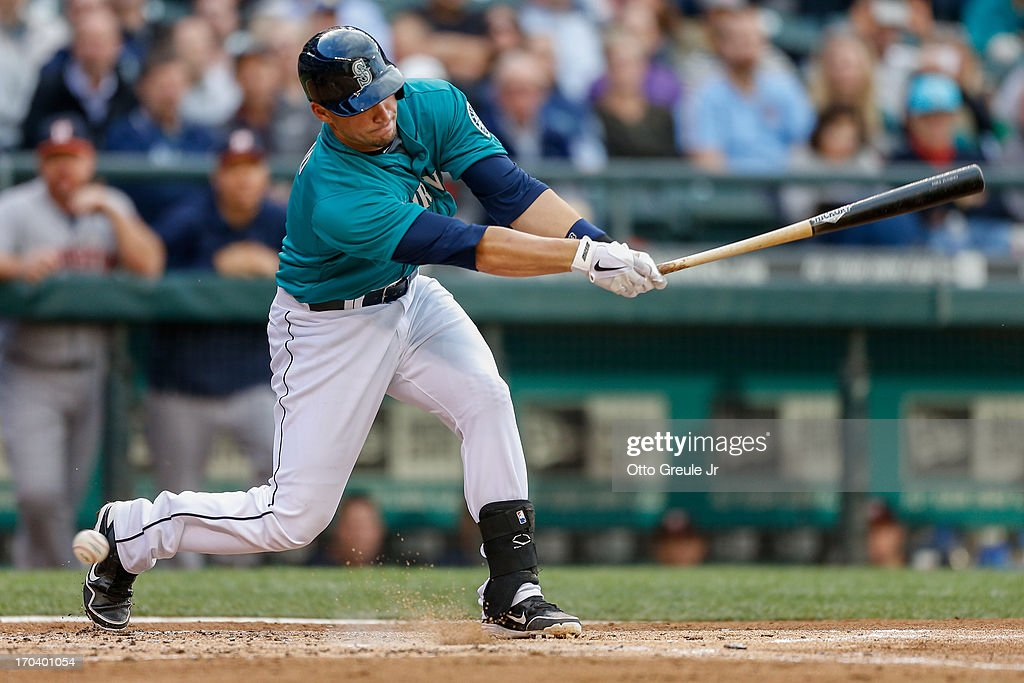 <a gi-track='captionPersonalityLinkClicked' href=/galleries/search?phrase=Mike+Zunino&family=editorial&specificpeople=6803368 ng-click='$event.stopPropagation()'>Mike Zunino</a> #3 of the Seattle Mariners strikes out in his first Major League at-bat in the second inning against the Houston Astros at Safeco Field on June 12, 2013 in Seattle, Washington.