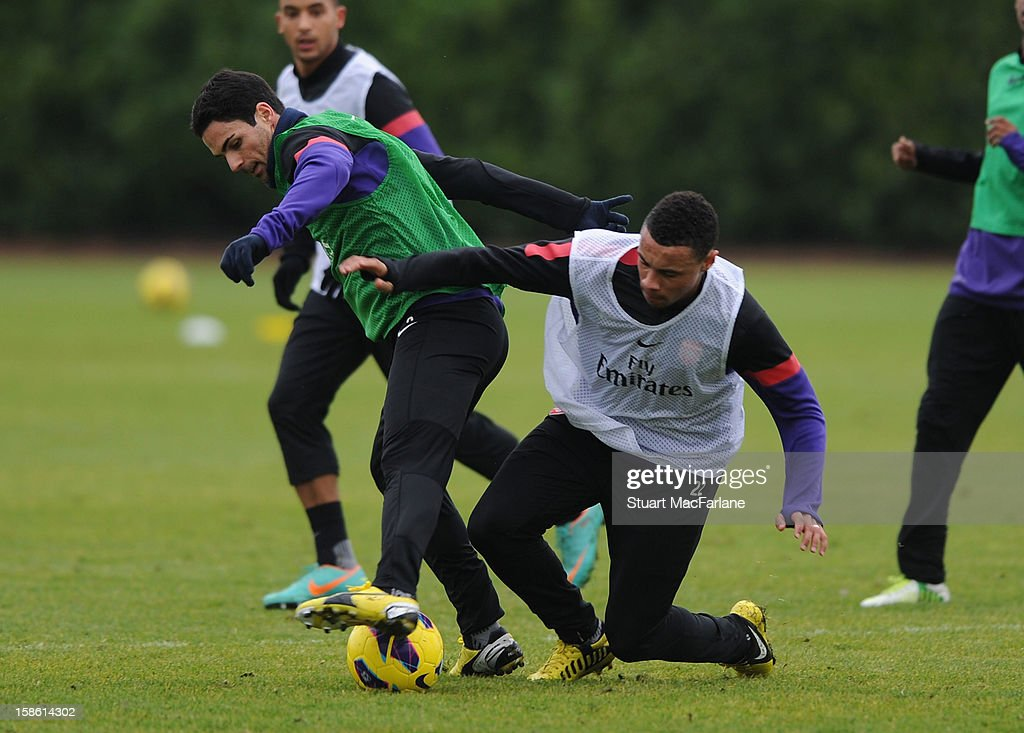 Mikel Arteta and Francis Coquelin of Arsenal during a training session at London Colney on December 21, 2012 in St Albans, England.