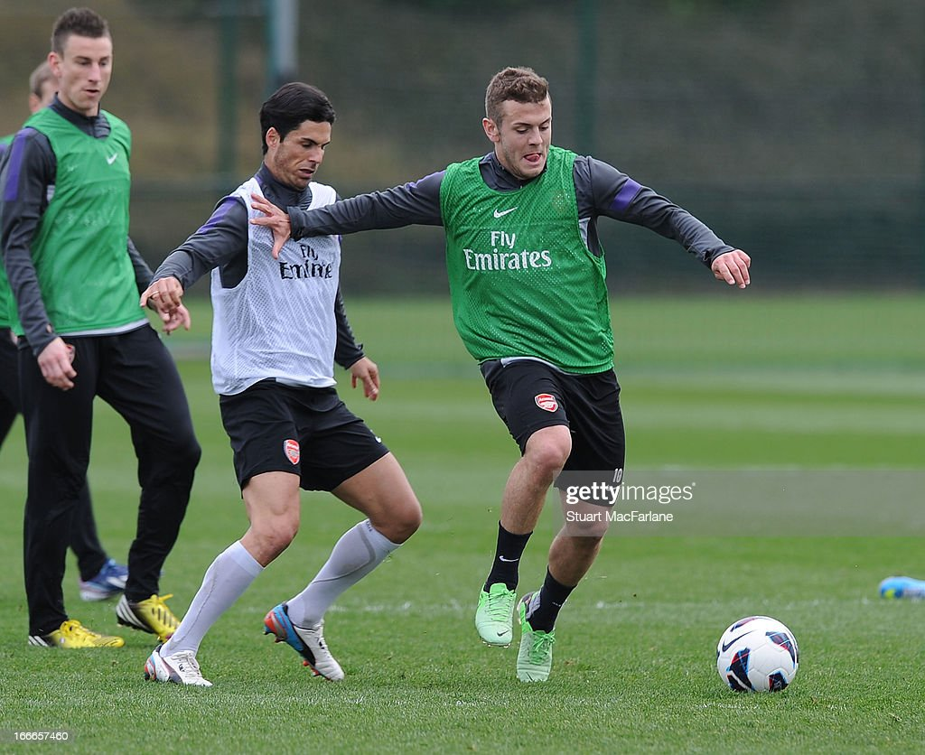 Mikel Arteta and Jack Wilshere of Arsenal during a training session at London Colney on April 15, 2013 in St Albans, England.