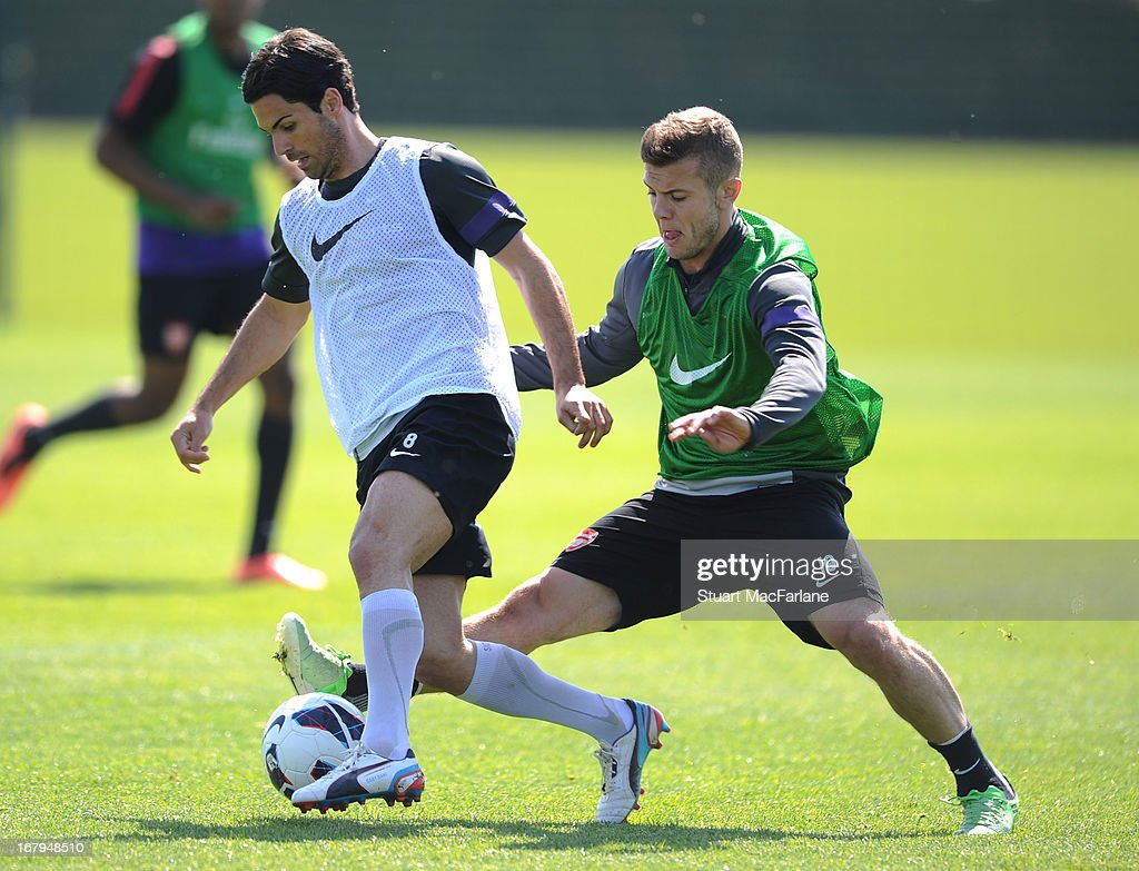 Mikel Arteta and Jack Wilshere of Arsenal during a training session at London Colney on May 03, 2013 in St Albans, England.