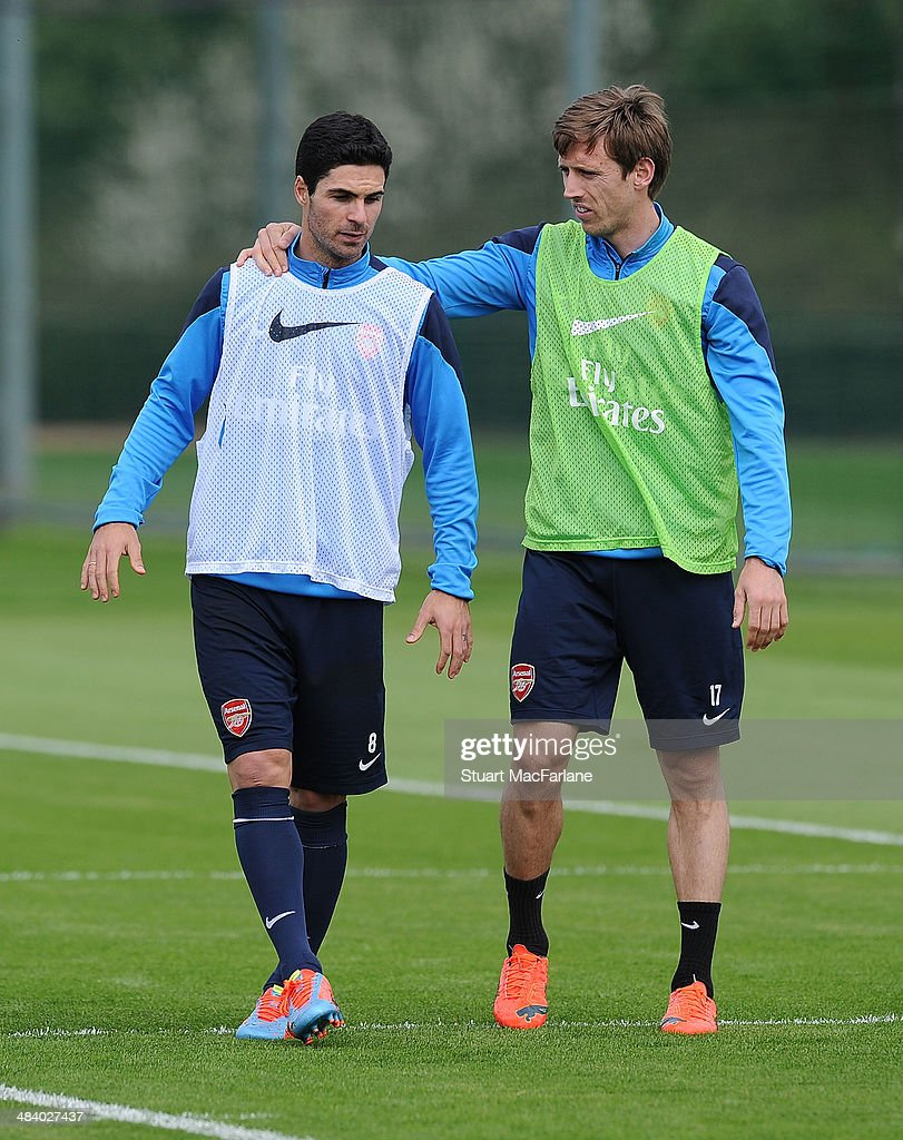 Mikel Arteta and Nacho Monreal of Arsenal during a training session at London Colney on April 11, 2014 in St Albans, England.