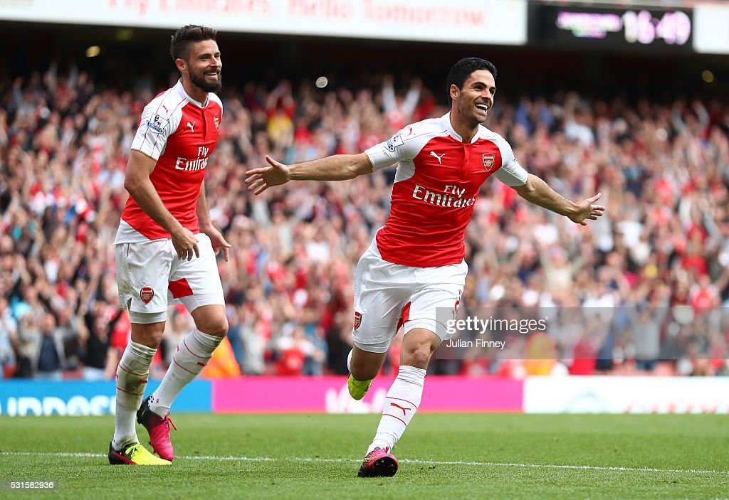 Mikel Arteta (R) and Olivier Giroud (L) of Arsenal celebrate their team's fourth goal scored own goal by Mark Bunn of Aston Villa during the Barclays Premier League match between Arsenal and Aston Villa at Emirates Stadium on May 15, 2016 in London, England.