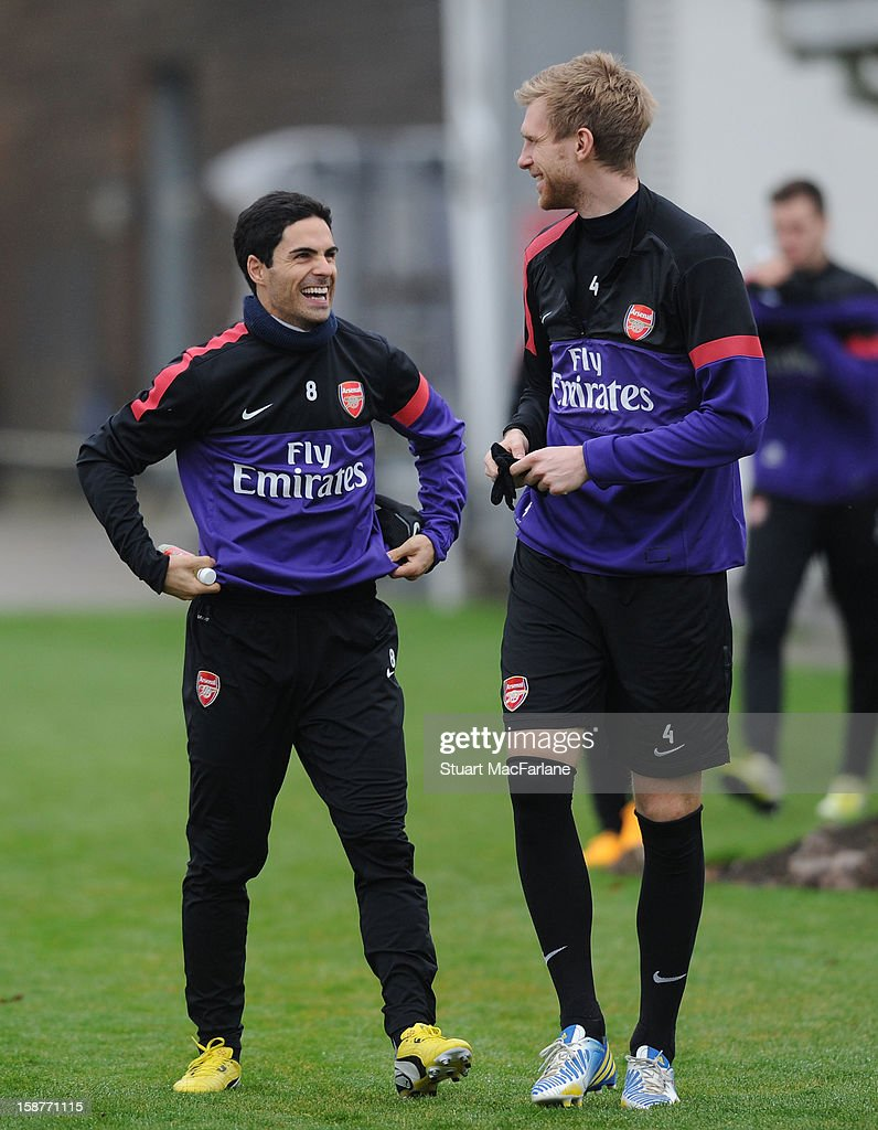Mikel Arteta and Per Mertesacker a training session at London Colney on December 28, 2012 in St Albans, England.