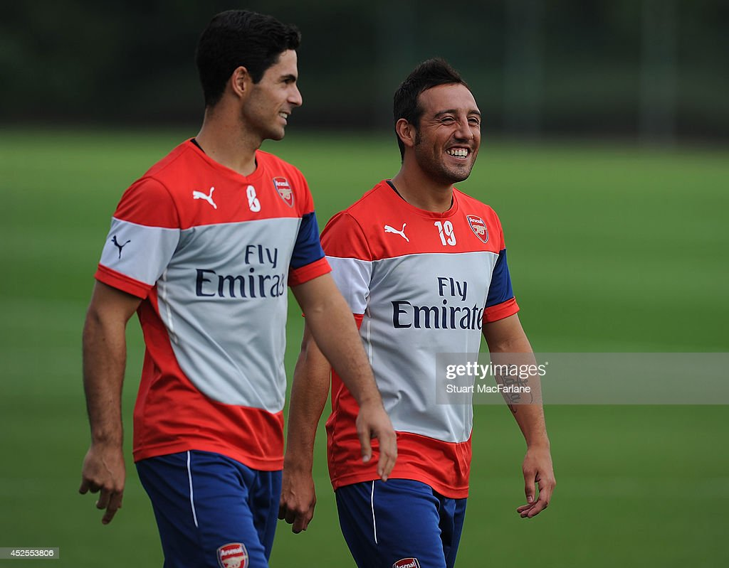 Mikel Arteta and Santi Cazorla of Arsenal before a training session at London Colney on July 23, 2014 in St Albans, England.
