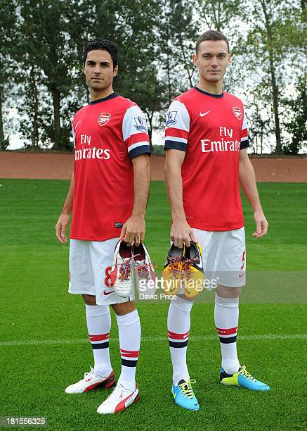 Mikel Arteta and Thomas Vermaelen of Arsenal pose with their rainbow laces during the Arsenal 1st team squad photoshoot at Arsenal Training Ground on...