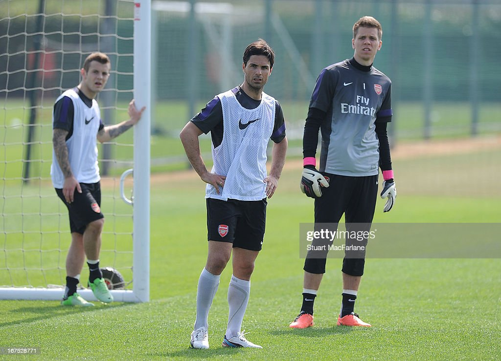 Mikel Arteta and Wojciech Szczesny of Arsenal during a training session at London Colney on April 26, 2013 in St Albans, England.