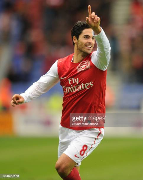 Mikel Arteta celebrates scoring the 1st Arsenal goal during the Barclays Premier League match between Wigan Athletic and Arsenal at DW Stadium on...