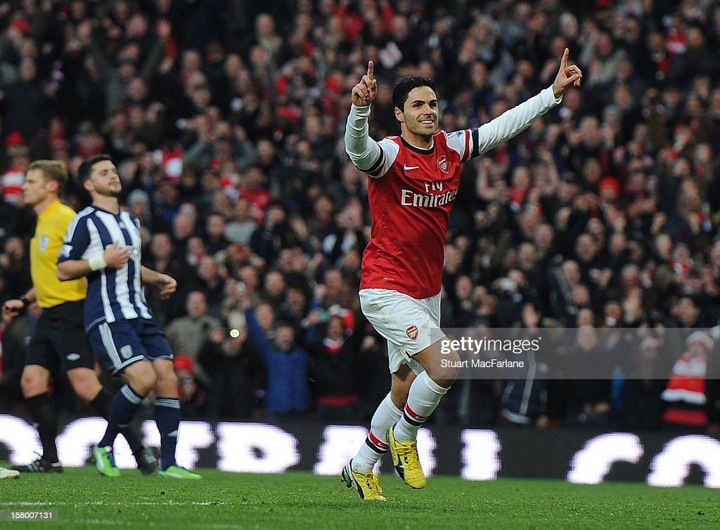 <a gi-track='captionPersonalityLinkClicked' href=/galleries/search?phrase=Mikel+Arteta&family=editorial&specificpeople=235322 ng-click='$event.stopPropagation()'>Mikel Arteta</a> celebrates scoring the 1st Arsenal goal during the Barclays Premier League match between Arsenal and West Bromwich Albion, at Emirates Stadium on December 08, 2012 in London, England.